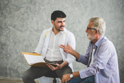 male physician talking to the old man