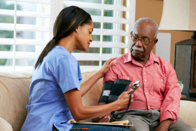 a lady getting the old man's blood pressure