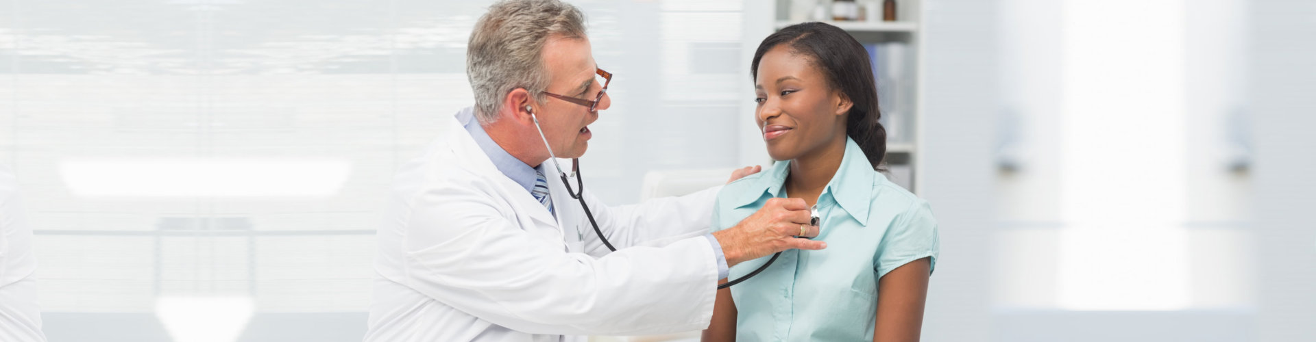 male physician checking up the patient